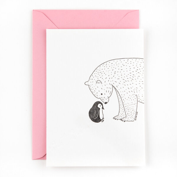 Little penguin meets a polar bear
